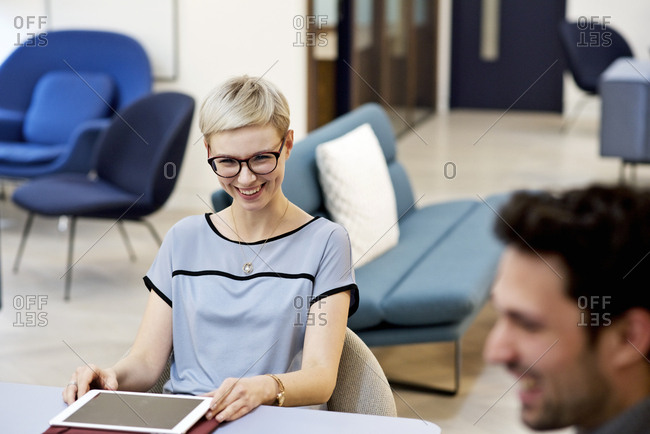 Woman having a laugh during meeting