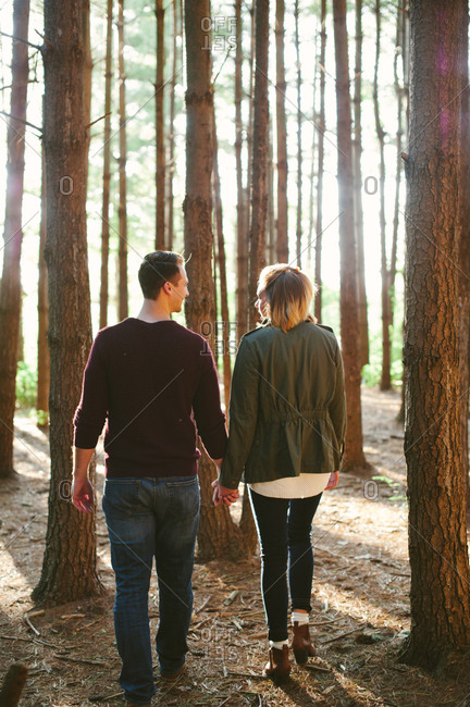 Couple strolling in fall woods
