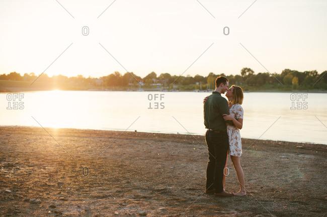 Couple embracing on lake shore