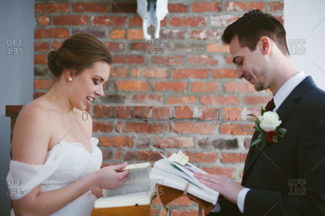 Bridal couple reading books