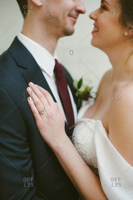 Close up of embracing bride and groom