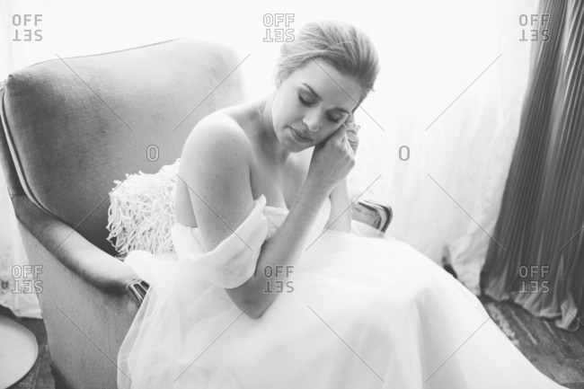 Bride putting on her earring