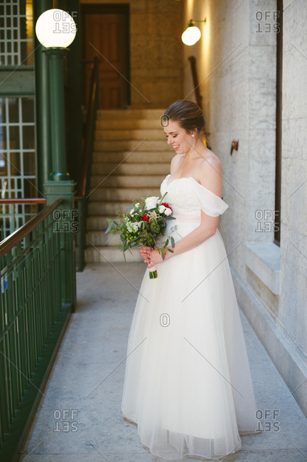 A bride in building with bouquet