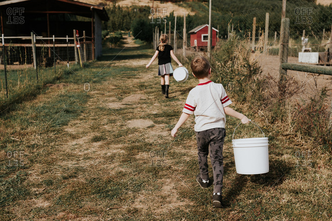 Children doing farm chores