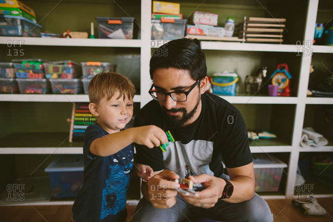 Dad and son playing with toys