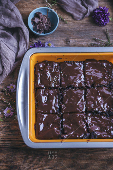 Chocolate sweet potato brownies in a baking pan on rustic wooden table