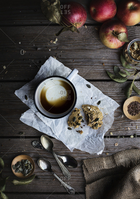 Pastry and cup of coffee on rustic wooden table. Top view breakfast