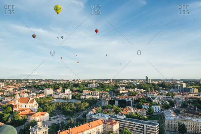 Aerial view of cityscape and air balloons