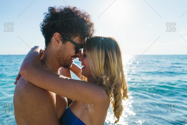 Loving couple posing on beach
