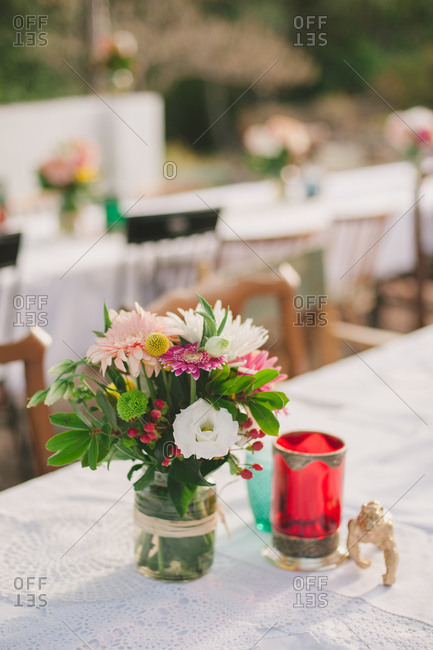 Floral centerpiece on table at an outdoor wedding