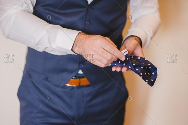 Groom folding his pocket square