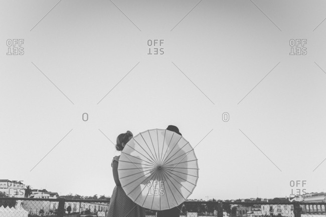 Couple holding sheer umbrella in black and white