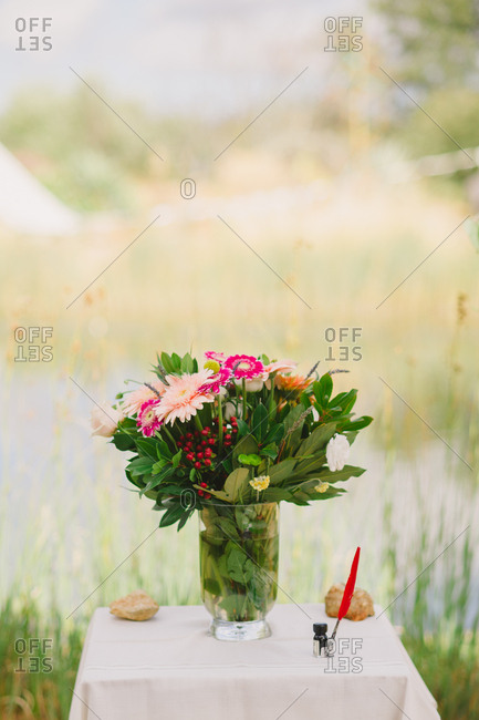 Floral arrangement on table at an outdoor wedding