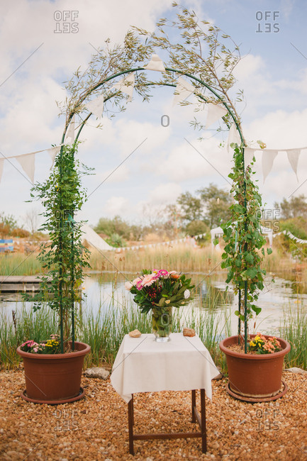Arbor and flowers at an outdoor wedding