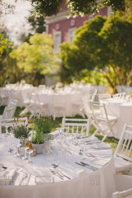 Round white tables at an outdoor wedding reception