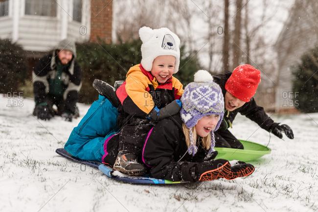 Family sledding together