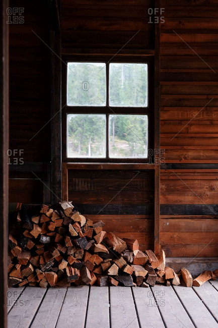 A stack of firewood at the boathouse