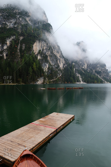 Boats docked on the lake in the Dolomites