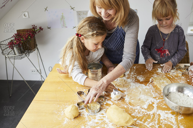 Grandmother and granddaughters baking Christmas cookies, detail,