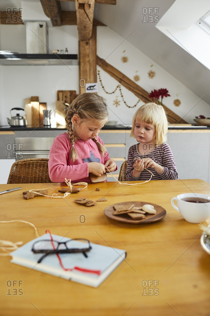 Two girls cozy at home while crafting