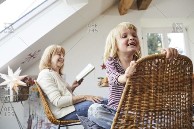Grandmother and granddaughter cozy at home in Christmas time
