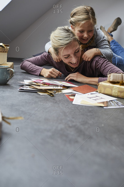 Mother and daughter writing Christmas cards