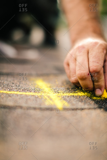 Construction worker marking lines for solar panel installation
