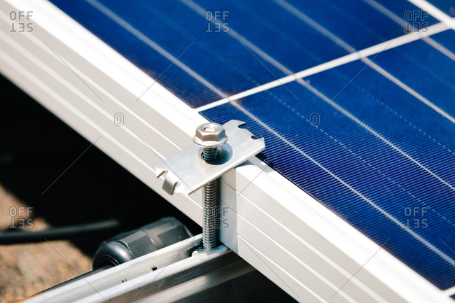 Close up of bolts on solar panels installed on a roof