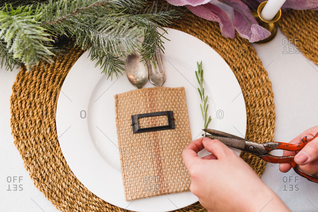 Hand cutting pine for place setting