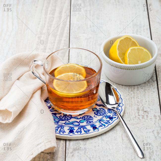 A drink with lemon in mug