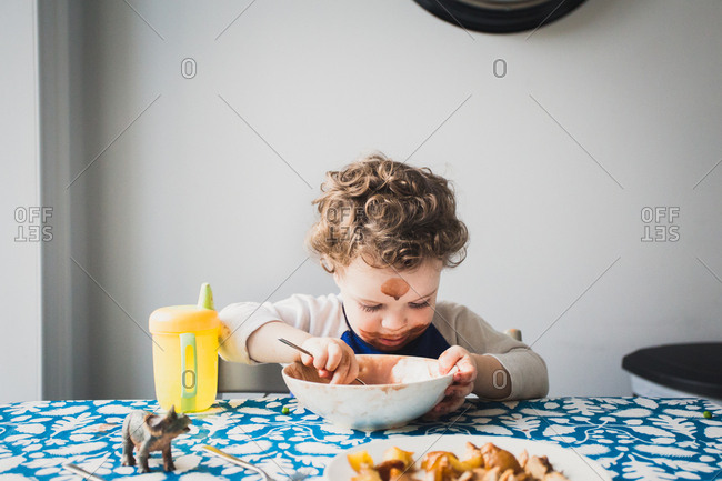 Toddler with messy face eating