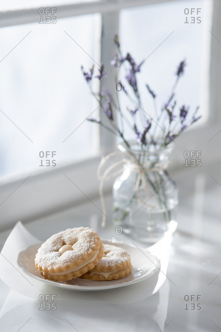 Linzer cookies with flowers on a window sill