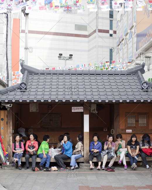 Seoul, South Korea - May 2, 2012: Ladies taking a break at Namdaemun Market, Seoul, South Korea
