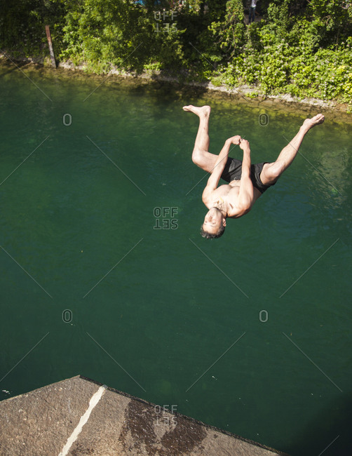 Zurich, Switzerland - June 7, 2014: Adrenaline seeker jumping into the Limmat River, Zurich, Switzerland