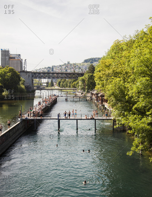 Zurich, Switzerland - June 7, 2014: Lazy summer afternoons by the Limmat River, Zurich, Switzerland