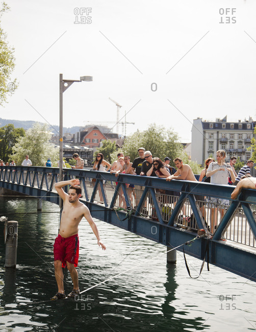 Zurich, Switzerland - June 7, 2014: Tightrope walking as one of the activities on the Limmat River, Zurich, Switzerland