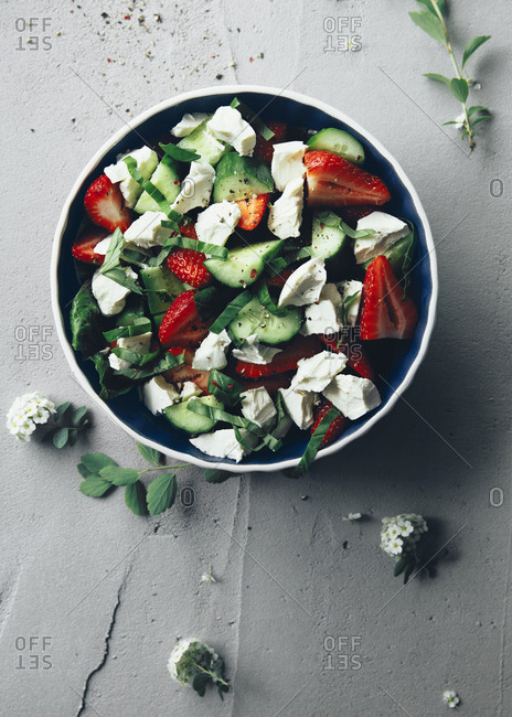 Colorful cucumber and strawberries salad