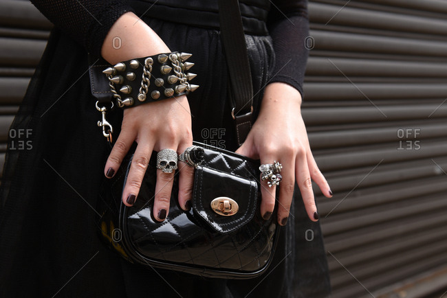 New York, NY - September 14, 2017: Goth woman all in black with bold accessories and skull ring