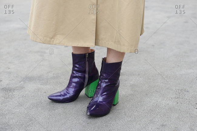 New York, NY - September 14, 2017: Woman wearing purple patent leather boots