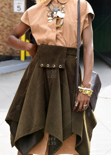 New York, NY - September 14, 2017: Fashionable woman in brown outfit with multiple accessories