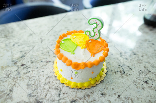Birthday cake with number 3 candle