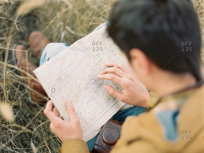 Man looking at map on a hiking trip