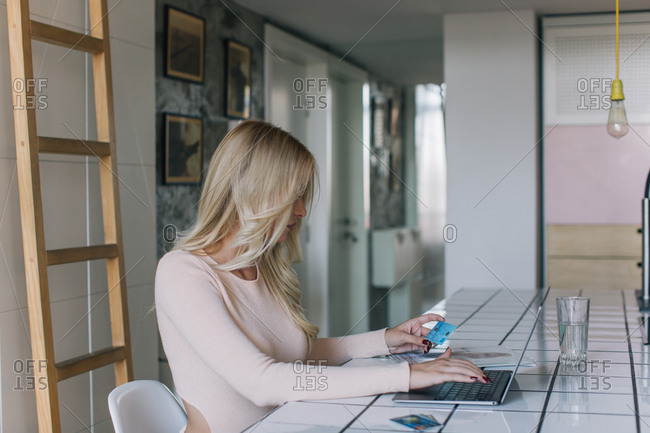 Blonde woman shopping online with credit cards
