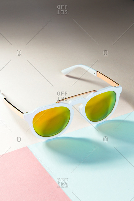 White sunglasses with yellow lenses still life
