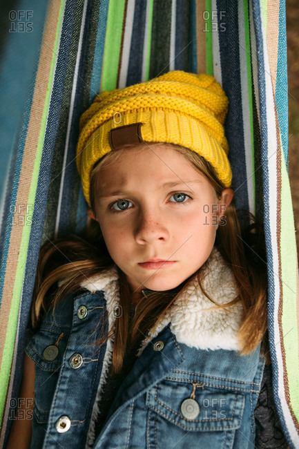 Portrait of a girl resting in a hammock