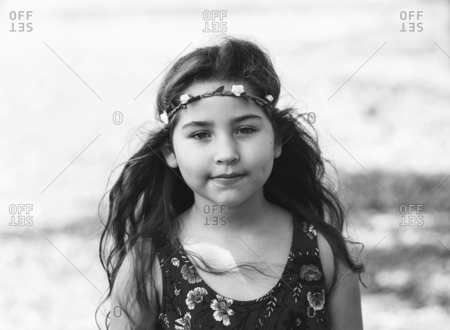 Black and white portrait of girl with flower head band