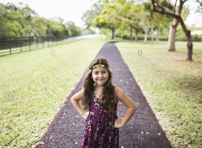 Confident girl standing on path