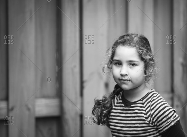 Portrait of girl with fence in background