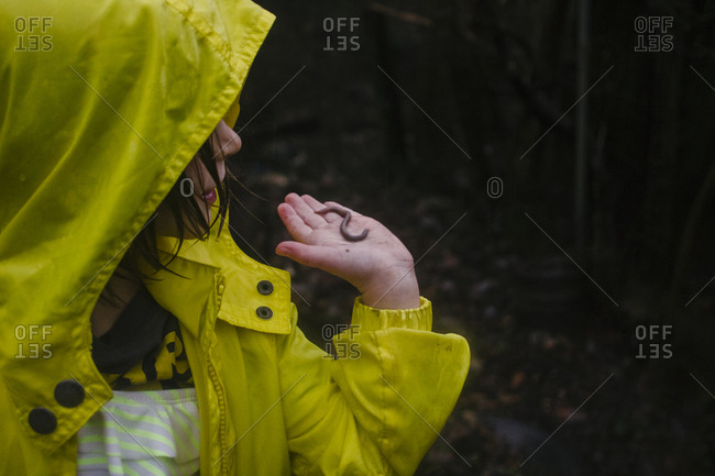 Girl holding worm in her hand
