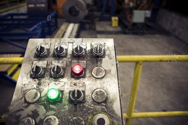 High angle view of buttons on messy control panel at metal industry